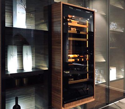 Photo gallery showing an example of a EuroCave Inspiration wine cabinet installed in a custom-made showcase.